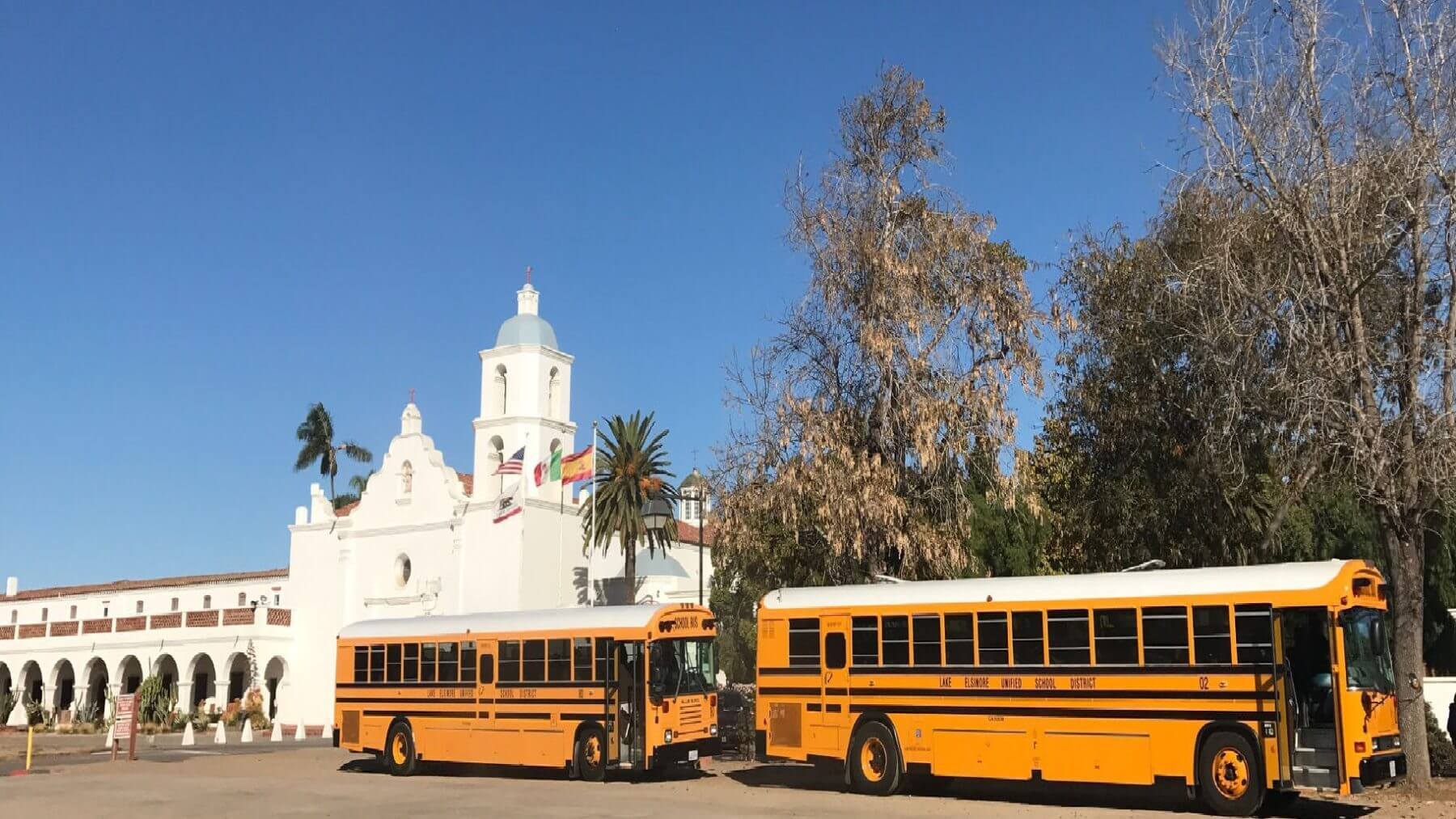 School-Buses-infront-of-Mission-San-Luis-Rey
